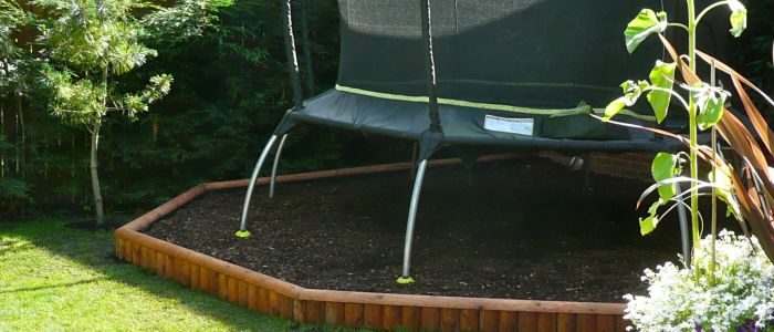 what is best to put under a trampoline